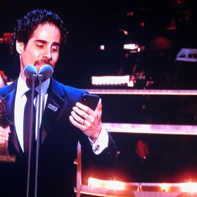 Alex Lacamoire, collecting Outstanding Achievement in Music for Hamilton, sings an acceptance from Lin-Manuel Miranda