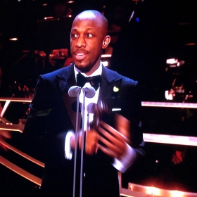 Giles Terera collects Best Actor in a Musical for Hamilton
