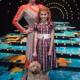 Craig Revel Horwood (Miss Hannigan), Ruby Stokes (Annie) and Amber (Sandy) - Annie at the Piccadilly Theatre - Photo credit Craig Sugden