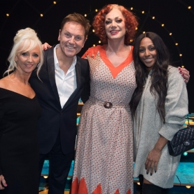 Debbie McGee, Brian Conley, Craig Revel Horwood (Miss Hannigan) and Alexandra Burke - Annie at the Piccadilly Theatre - Photo credit Craig Sugden