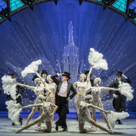 Haydn Oakley & cast in An American in Paris at London's Dominion Theatre. © Johan Persson